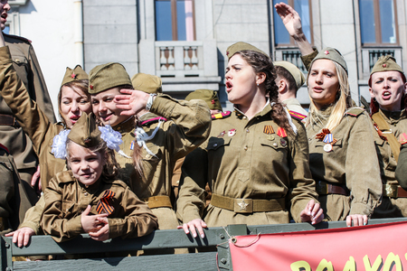 regiment: Young girls in uniform. Holiday-action Immortal regiment taking place in St. Petersburg on Nevsky Prospect.