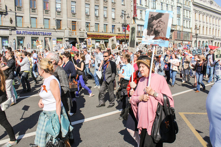 regiment: Walking people in the convoy. Holiday-action Immortal regiment taking place in St. Petersburg on Nevsky Prospect. Editorial