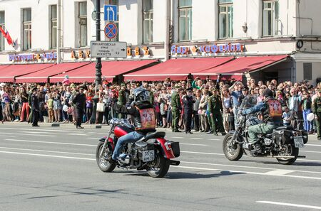 regiment: A couple of bikers on motorcycles. Holiday-action Immortal regiment taking place in St. Petersburg on Nevsky Prospect. Editorial