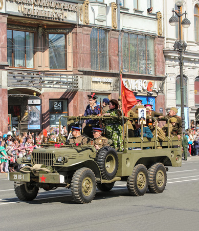 nevsky prospect: People in the old military truck. Holiday-action Immortal regiment taking place in St. Petersburg on Nevsky Prospect. Editorial