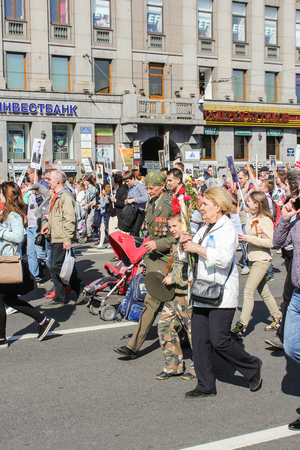 regiment: A veteran with medals. Holiday-action Immortal regiment taking place in St. Petersburg on Nevsky Prospect. Editorial