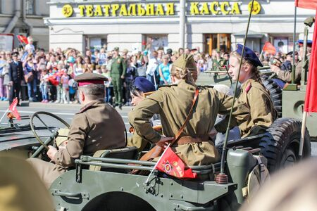 nevsky prospect: People in military uniform in the car. Holiday-action Immortal regiment taking place in St. Petersburg on Nevsky Prospect.