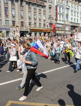 regiment: People going to the Immortal regiment. Holiday-action Immortal regiment taking place in St. Petersburg on Nevsky Prospect.