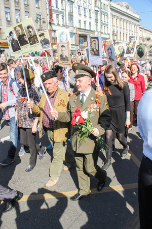 nevsky prospect: A military officer with flowers to the portrait. Holiday-action Immortal regiment taking place in St. Petersburg on Nevsky Prospect.