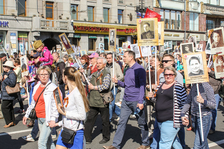 regiment: Procession of people with their portraits. Holiday-action Immortal regiment taking place in St. Petersburg on Nevsky Prospect.