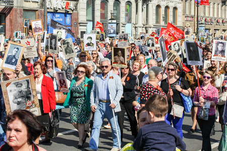 regiment: Crowd of people with portraits of relatives in his hands. Holiday-action Immortal regiment taking place in St. Petersburg on Nevsky Prospect. Editorial