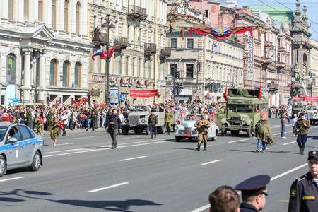 regiment: Vintage cars in action Immortal regiment. Holiday-action Immortal regiment taking place in St. Petersburg on Nevsky Prospect.