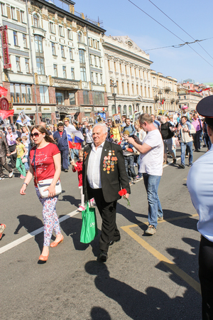 nevsky prospect: An elderly man with medals. Holiday-action Immortal regiment taking place in St. Petersburg on Nevsky Prospect.