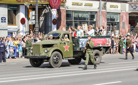 regiment: Military truck with people. Holiday-action Immortal regiment taking place in St. Petersburg on Nevsky Prospect.