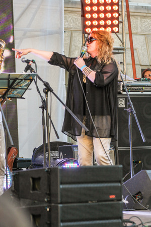 soloist: Soloist with an outstretched hand. Annual international festival of jazz and blues in St. Petersburg.