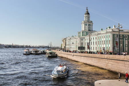 The building of the Kunstkamera and Museum of Anthropology. Travel types of summer Saint-Petersburg along the Neva River.