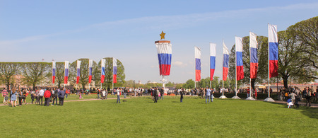 vacationers: Exchange Square with flags. Vacationers people on the lawns and gardens in the city. Editorial