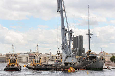 formulation: Work on the formulation of the cruiser Aurora on the parking lot. Statement of the legendary cruiser Aurora on eternal parking place after repair. Editorial
