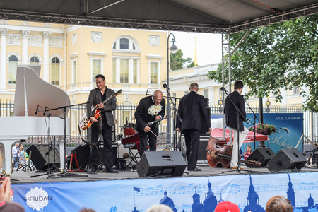 maestro: Maestro in a bow on stage. Speech by David Goloschekin with his jazz group on the Arts Square in St. Petersburg. Editorial