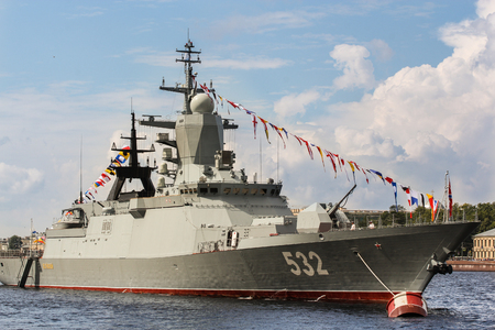 Warship with signal flags. Festive parade of warships on the Neva River in St. Petersburg.