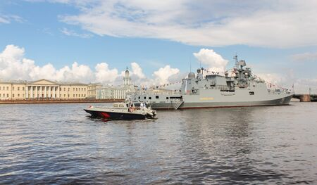 The boat is a large warship. Festive parade of warships on the Neva River in St. Petersburg.