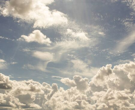cirrus: Cumulus and cirrus clouds illuminated by the sun. Stock Photo