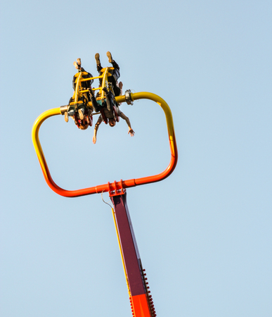whirling: Whirling in the air people. Amusement and extreme rides for teenagers and adults.