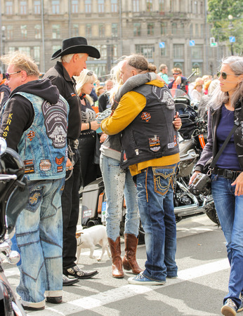 familiar: The meeting familiar people. The annual parade of Harley Davidson in the squares and streets of St. Petersburg. Editorial