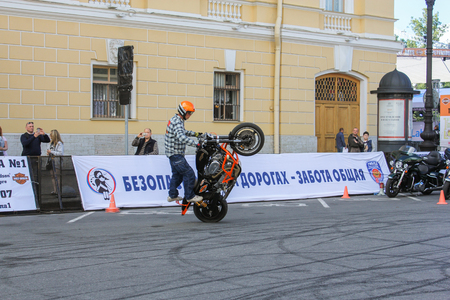 rear wheel: The rise of the bike on the rear wheel. The annual International Festival of Motor Harley Davidson in St. Petersburg Ostrovsky Square. Editorial