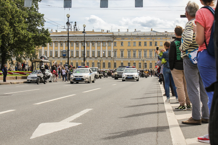 escort: Police escort vehicles. The annual parade of Harley Davidson in the squares and streets of St. Petersburg.