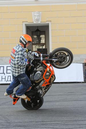 demonstrative: Demonstrative performance biker. The annual International Festival of Motor Harley Davidson in St. Petersburg Ostrovsky Square.
