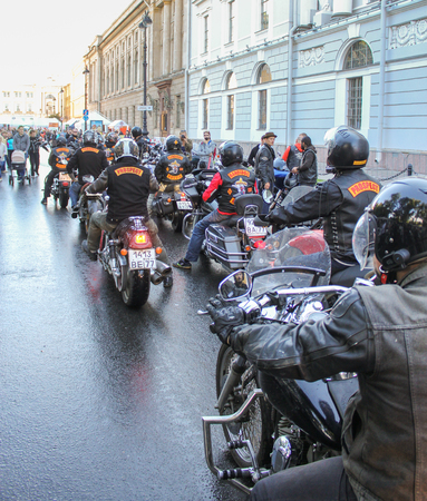 Arriving at the festival group of bikers. The annual International Festival of Motor Harley Davidson in St. Petersburg Ostrovsky Square. Editorial