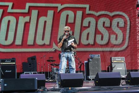 entertainer: Entertainer on stage. Sport dancing men on Harley Davidson festival in St. Petersburg.