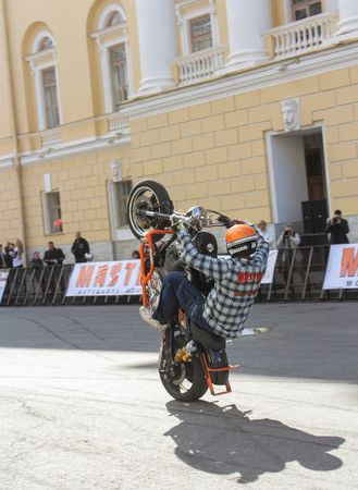 rear wheel: Riding vertically on the rear wheel. The annual International Festival of Motor Harley Davidson in St. Petersburg Ostrovsky Square.