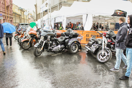 Motorcycles parked on wet. The annual International Festival of Motor Harley Davidson in St. Petersburg Ostrovsky Square. Editorial