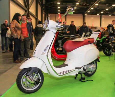 White retro scooter. Motorcycles and motoconcepts presented at St. Petersburg Motor Show.