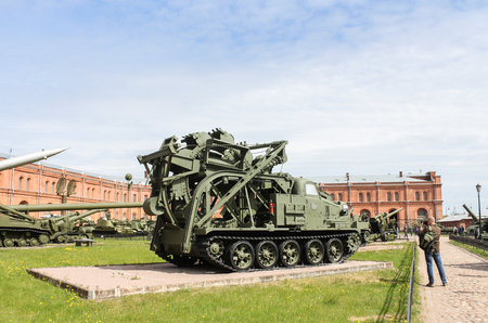 A man is photographing military equipment. Military History Museum of combat equipment in St. Petersburg Petersburg. Editorial