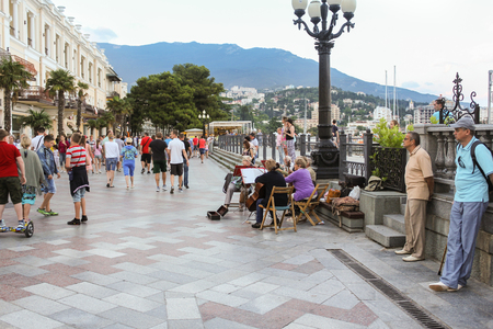 Musical quartet on the waterfront. Streets and embankments of the seaside city of Yalta.