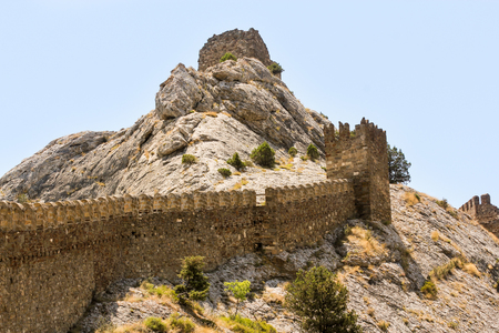 sudak: Fragments of the fortress on a stone summit. Genoese ancient fortress near the city of Sudak.