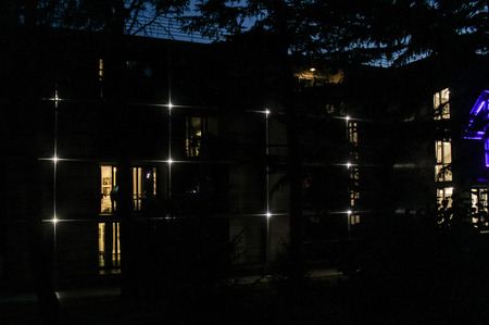 Night illumination of the hotel. Night surroundings and adjoining territories of hotel Yalta Intourist.