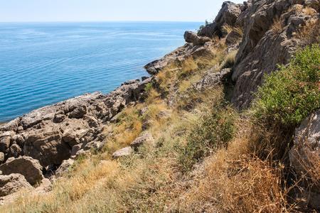 Stone slope to the sea. Stock Photo
