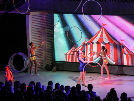 Girls juggling with rings on stage. Performance of young artists on the stage of the hotel Yalta Intourist .. Stock Photo