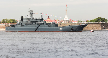 Festive parade of warships on the Neva River in St. Petersburg.