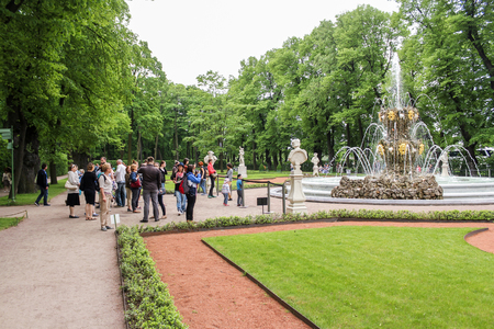 Walking through the Summer Garden of St. Petersburg in cloudy, rainy weather. Editorial