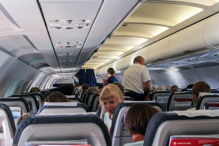 Passengers and attendants in the cabin of the airliner.
