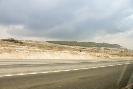 Construction of the highway Tavrida in Crimea from the window of a car.