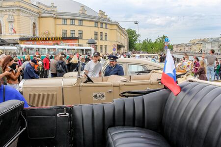 The parade of retro transport and cars on the day of the city in St. Petersburg. Редакционное