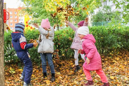 Photo of children in the autumn kindergarten on the street. Redakční