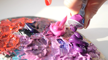 artist squeezes from the tube to the palette purple oily pink paint , HD.