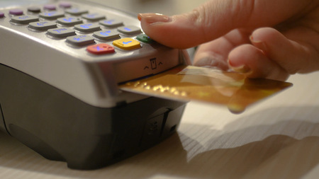 Click on the keyboard on the bank terminal, make purchases in the store. HD