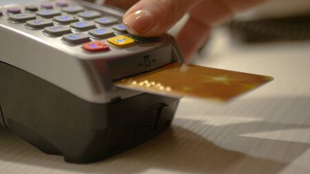 Spend electronic money through the card and the bank terminal in the store. HD