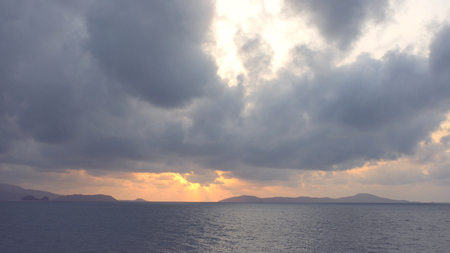 Beautiful dawn in the clouds above the hills and the sea. HD 스톡 콘텐츠