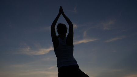 pose in yoga with a beautiful view of the evening blue sky. HD