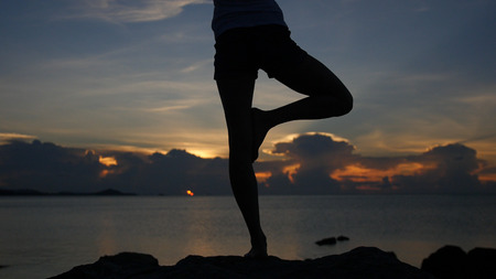 The best view for yoga at sea with a golden sunset. HD