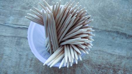 abstract wooden toothpicks on wood background